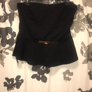 Strapless top with gold bar at waist.